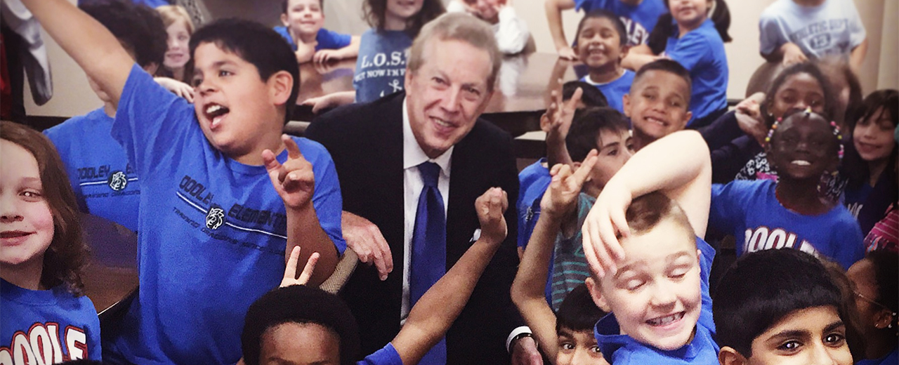 Visual representation of Richard H. Collins with students.